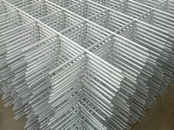 Many plain square reinforcing welded meshes stacked up